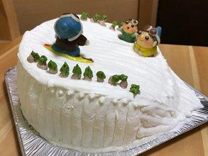 スノーボードのマスコット付き立体ケーキ