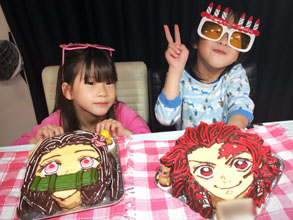 禰津子と炭治郎のマスコット人形付き顔型立体ケーキ